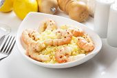 Delicious spicy shrimps served with cooked rice poster