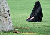 picture of yashmak  - Woman sitting on grass in full hijab  - JPG