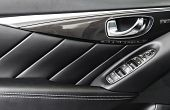 Door Handle With Power Window Control Buttons Of A Luxury Passenger Car. Black Perforated Leather In poster