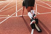 Cropped photo of handsome strong young sportsman running outdoors ready to run. poster