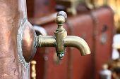 Water Brass Crane Of A Copper Antiquarian Samovar Close Up. poster