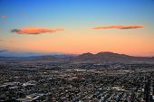 stock photo of las vegas casino  - Las Vegas city aerial view panorama sunset with mountain - JPG