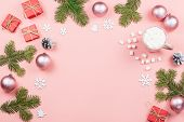 Christmas Background With Fir Tree Branches, Red Giftboxes, Pink Decorations, Hot Drink With Marshma poster