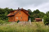 Wooden Log Cabin House Newly Built With Small Windows, New Roof Tiles, Gutter, Camera, Light Reflect poster