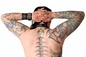 image of groupies  - back of a man covered with lot of tattoos - JPG