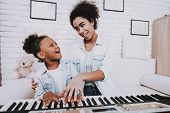 Happy Day For Mother And Happy Day For Young Girl. Mother Help Young Girl With Piano. Smile Young An poster