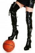 image of thigh highs  - Female legs in thigh high vinyl boots with basketball over white - JPG