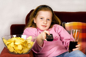 pic of potato chips  - little girl is zapping TV with cola and potatoe chips - JPG