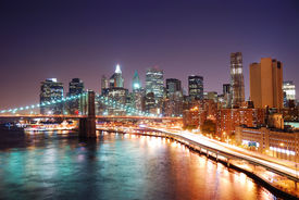 picture of brooklyn bridge  - New York City Manhattan skyline and Brooklyn Bridge with skyscrapers over Hudson River illuminated with lights and busy traffic at dusk after sunset - JPG