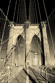 stock photo of brooklyn bridge  - New York City Brooklyn Bridge in Manhattan closeup with skyscrapers and city skyline over Hudson River - JPG