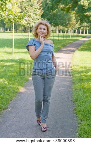 Beautiful Woman Walking In The Park. Summer Day.