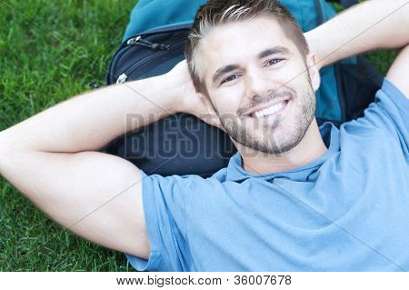 Portrait Of A College Student Lying In Grass