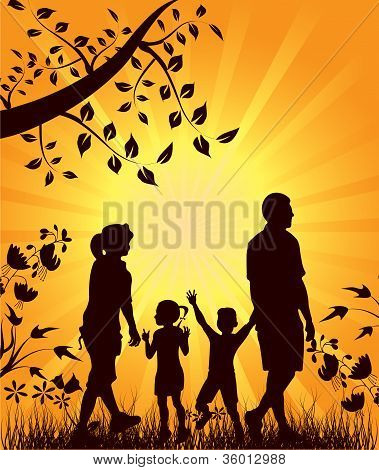 Happy Family Walks In Nature At Sunset