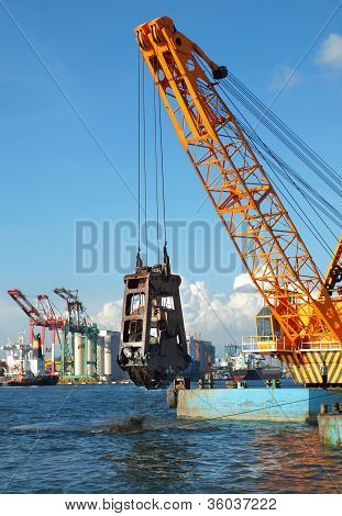 Dredger Lifts Mud From Harbor Berth