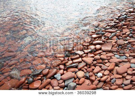 Shoreline Tumbled Pebbles And Bricks