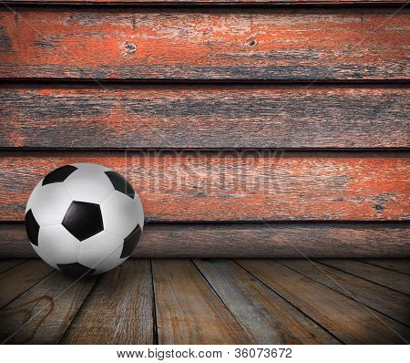 soccer football on wood texture background