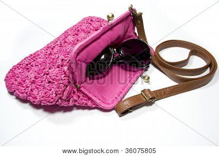 Pink ladies handbag and  book