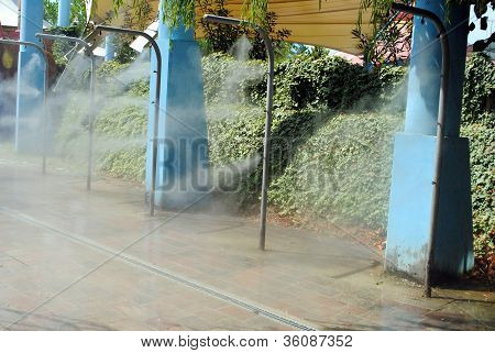 nebulizing showers with cold water concept of sultriness