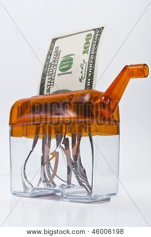 Dollar Banknote In A Paper Shredder Portays  Decreasing Value Of  Money