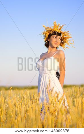 Young woman on wheat field