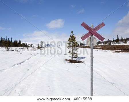 Snowmobile sign in springtime.