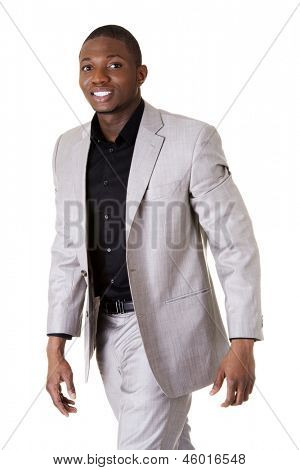 A young businessman is walking. Isolated over white background