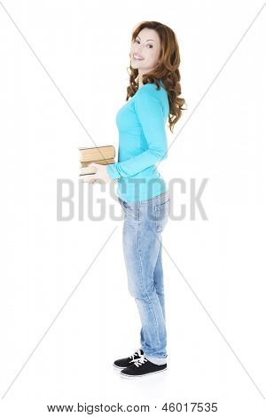 Attractive adult woman with book, isolated on white
