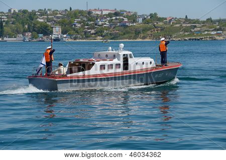 SEVASTOPOL, UKRAINE - MAY 8: Boat of commander of Russian navy go to the military ship anchored in the harbor of Sevastopol, Crimea, Ukraine on May 8, 2013