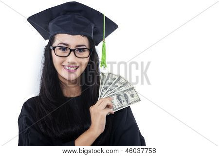 Attractive Woman In Graduation Gown Holding Money