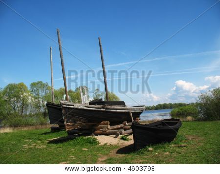 Ancient Fishermens Boats On The Lake Coast