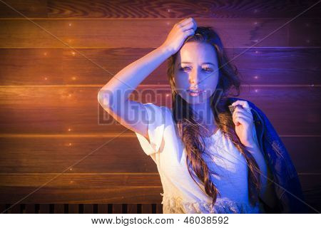 Portrait of a Pretty Mixed Race Young Adult Woman Against a Lustrous Wooden Wall Background.