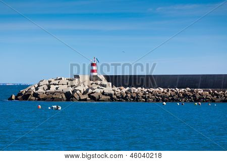 Pier With Lighthouse At Sagres, Portugal