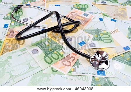 Stethoscope on the full frame of Euro money banknotes