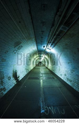Empty tunnel at night - Light at the end of  tunnel