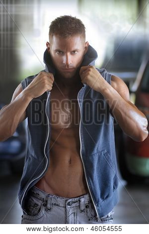 Fashion portrait of a sexy muscular male model