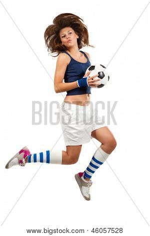 Girl jumping with soccer ball in mid air with over white background