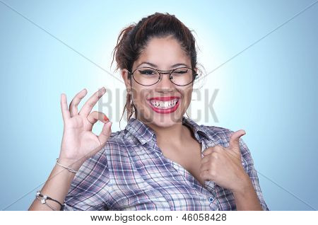 Girl Winking With Thumb Up And Ok Sign