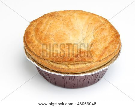 Steak meat pie in aluminium foil tray. Focus on centre of pastry top.
