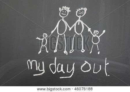 Blackboard With A Child's Drawing Of A Happy Family Day Out.