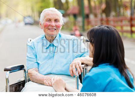 Nurse Consoling Senior Patient
