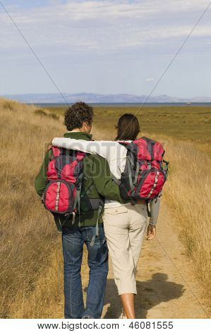 Rear view of couple hiking