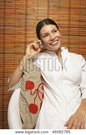 Woman sitting and talking on cell phone