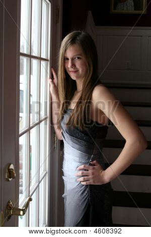 Beautiful Teenage Girl In Natural Light By A French Door