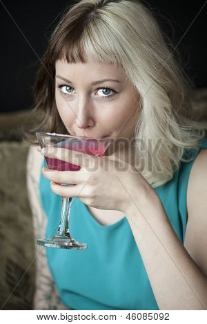 Beautiful Young Woman Drinking Pink Martini