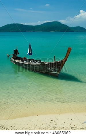 The fishing boat at the beach and sky