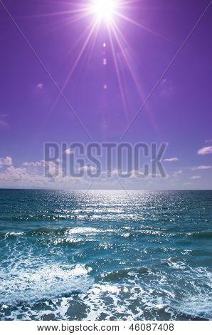 Sparkling sunlight. Purple sky and sea