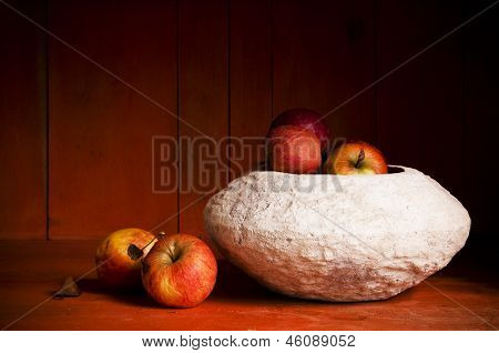 Still life with apples in a bowl, in a sideboard