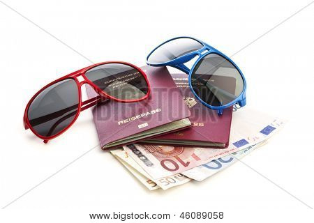Two sunglasses upon german passports and Euro currency