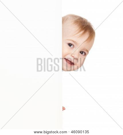 Boy Emerge From Behind Poster.