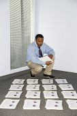 picture of collate  - Young businessman collating reports - JPG